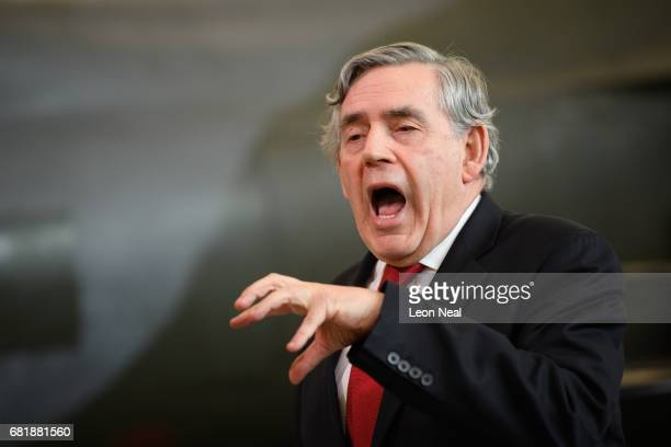Former British Prime Minister Gordon Brown stands in front of a Jump Jet Harrier fighter plane as he addresses Labour supporters at a rally in the...