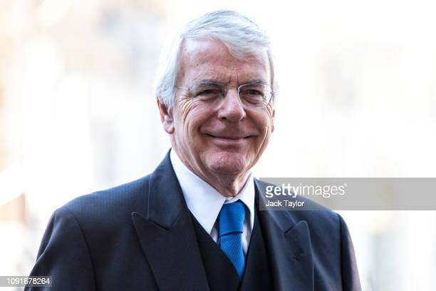 Former British Prime Minister John Major arrives for a memorial service for Conservative Peer Lord Carrington at Westminster Abbey on January 31,...
