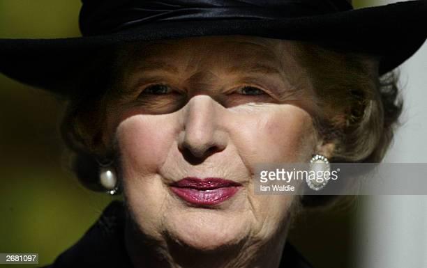 Former British Prime Minister Margaret Thatcher arrives for the memorial service for her husband Denis October 30 2003 in London England Sir Denis...