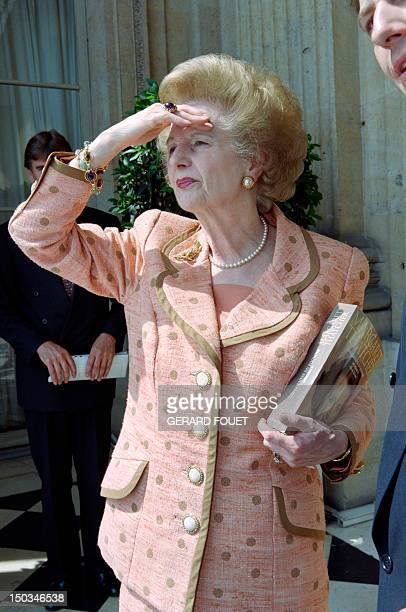 Former British Prime Minister Margaret Thatcher poses in front of the Place de la Concorde at the hotel Crillon balcony in Paris on June 22 where she...