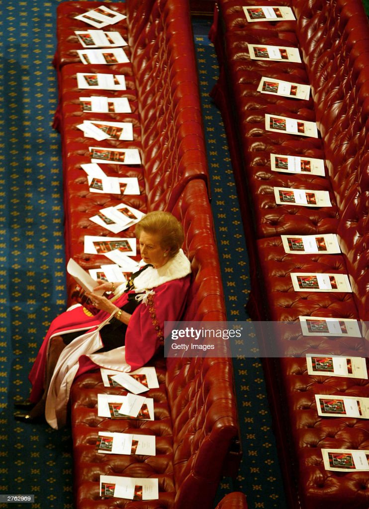 Former British Prime Minister Margaret Thatcher waits for Queen Elizabeth II to speak in the House of Lords at the State Opening of Parliament on November 26, 2003 in London, England.