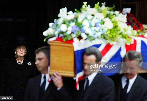 Former British Prime Minister Margaret Thatcher watches as the coffin of her husband Sir Denis Thatcher is taken from The Royal Hospital Chapel July...