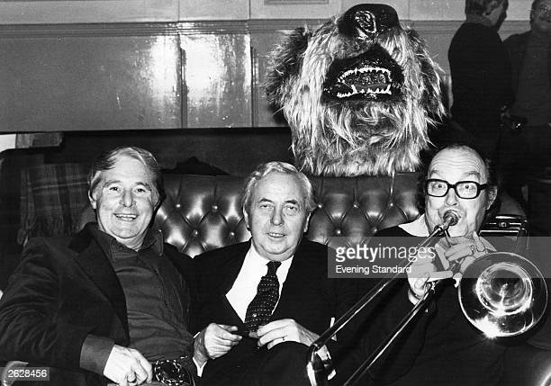 Former British prime minister Sir Harold Wilson sitting between comedy duo Morecambe and Wise Ernie Wise is on the left and Eric Morecambe is playing...