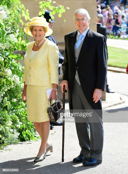 Former British Prime Minister Sir John Major and his wife Dame Norma Major arrive at St George's Chapel at Windsor Castle before the wedding of...