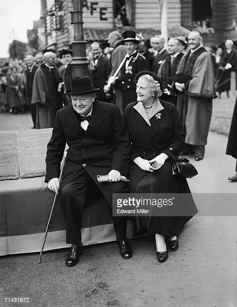 Former British Prime Minister Sir Winston Churchill with his wife Clementine at a civic parade in his Woodford constituency to mark the forthcoming...