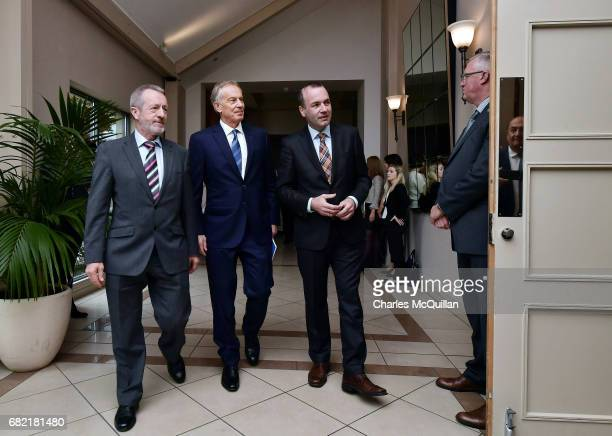 Former British Prime Minister Tony Blair and EPP Group Chairman Manfred Weber arrive for the European People's Party Group Bureau meeting at Druids...