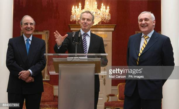 Former British Prime Minister Tony Blair centre with US Senator George Mitchell left and outgoing Irish premier Bertie Ahern right during a meeting...