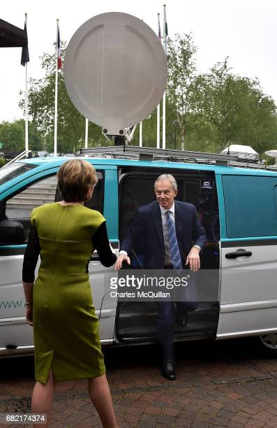 Former British Prime Minister Tony Blair exits a television satellite broadcast van as he attends the European People's Party Group Bureau meeting at...