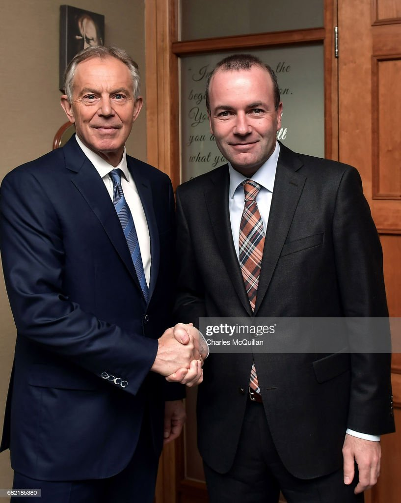 Former British Prime Minister Tony Blair (L) is greeted by EPP Group Chairman Manfred Weber (R) as he arrives for the European People's Party Group Bureau meeting at Druids Glen on May 12, 2017 in Wicklow, Ireland. Brexit and negotiating objectives will top the agenda at the meeting alongside the unique circumstances regarding the hard border issue between northern and southern Ireland, the only physical border between the United Kingdom and Europe. Mr Blair has signaled a return to politics in light of the Brexit vote. The meeting also features European Commission Brexit chief negotiator Michel Barnier.