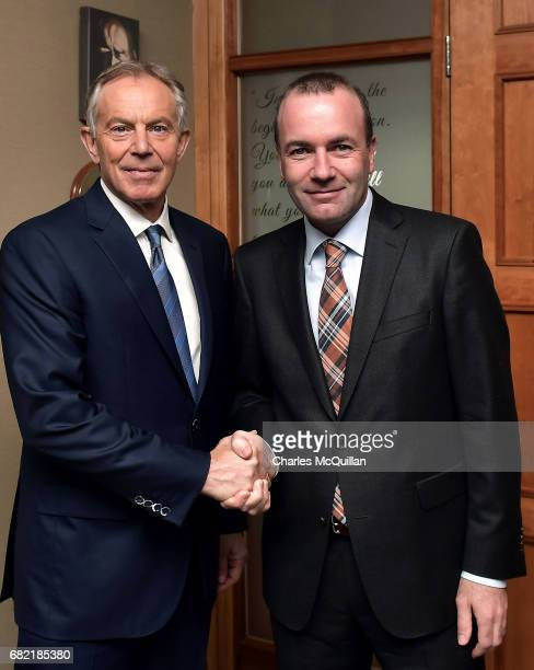 Former British Prime Minister Tony Blair is greeted by EPP Group Chairman Manfred Weber as he arrives for the European People's Party Group Bureau...