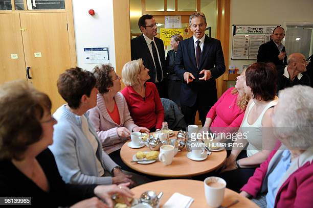 Former British prime minister Tony Blair meets people at the Pioneering Partnership centre in Newton Aycliffe in Durham northeast England after...