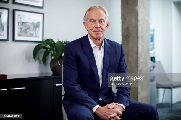 Former British Prime Minister Tony Blair poses for a photograph ahead of an interview with AFP in central London on July 17 2018 'It's a total and...