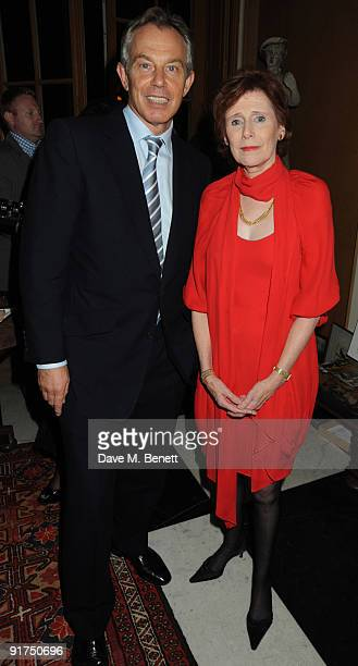 Former British Prime Minister Tony Blair poses with Marjorie Wallace during a charity Gala art and music recital event in aid of mental health...