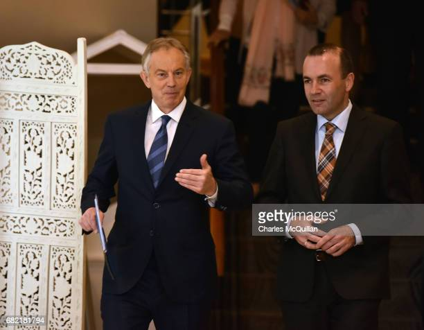 Former British Prime Minister Tony Blair speaks with EPP Group Chairman Manfred Weber as he arrives for the European People's Party Group Bureau...