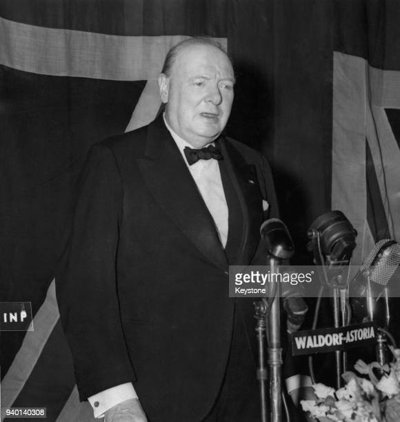 Former British Prime Minister Winston Churchill addresses a banquet at the Waldorf-Astoria in New York City, 15th March 1946. He is calling on the...