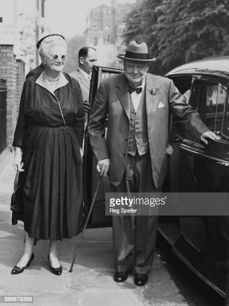Former British Prime Minister Winston Churchill and his wife Clementine arrive home at Hyde Park Gate London having driven from the airport 11th May...
