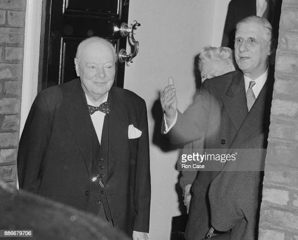 Former British Prime Minister Winston Churchill and his wife Clementine greet French President Charles de Gaulle upon his arrival at Sir Winston's...