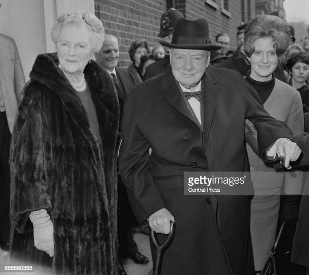Former British Prime Minister Winston Churchill and his wife Clementine leave their daughter Mary's flat in Westminster London after a family lunch...