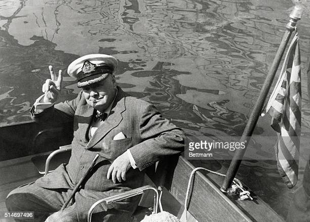 Former British Prime Minister Winston Churchill gives the victory sign while riding in a motor lauch in the harbor at Safi Morocco He is on his way...