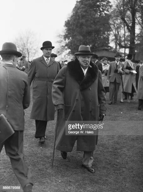 Former British Prime Minister Winston Churchill in the paddock at Sandown Park Racecourse Surrey UK 27th April 1957 He has a runner on 'Le...