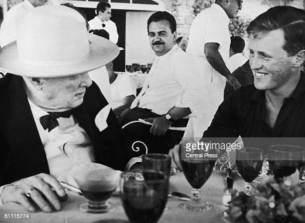 Former British Prime Minister Winston Churchill with his grandson and namesake at a tavern near Athens during a holiday cruise July 1963