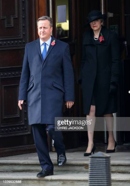 Former British Prime Ministers David Cameron and Theresa May attends the Remembrance Sunday ceremony at the Cenotaph on Whitehall in central London,...