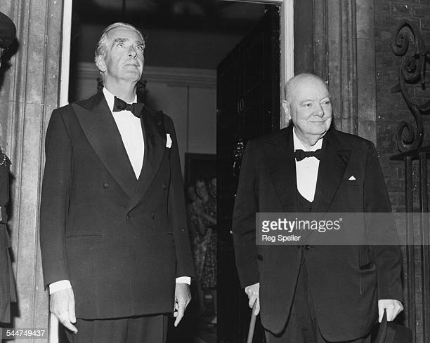 Former British Prime Minister's Sir Anthony Eden and Sir Winston Churchill attending a dinner party in honor of President Eisenhower at 10 Downing...