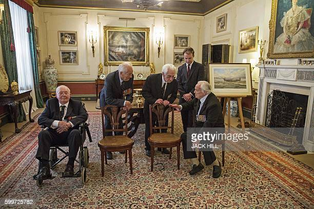 Former British Royal Air Force offiers Squadron Leader Dick Summer Squadron Leader Tim Elkington Flight Officer Ken Wilkinson and Squadron Leader...