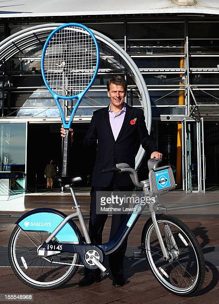 Former British tennis No 1 Andrew Castle poses with a Barclays Cycle Hire bike on the opening day of the Barclays ATP World Tour Finals to launch...