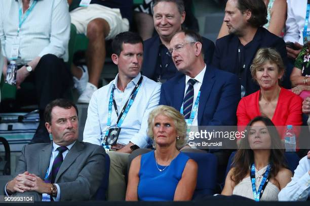 Former British tennis player Tim Henman and All England Club CEO Richard Lewis watch the semifinal match between Kyle Edmund of Great Britain and...