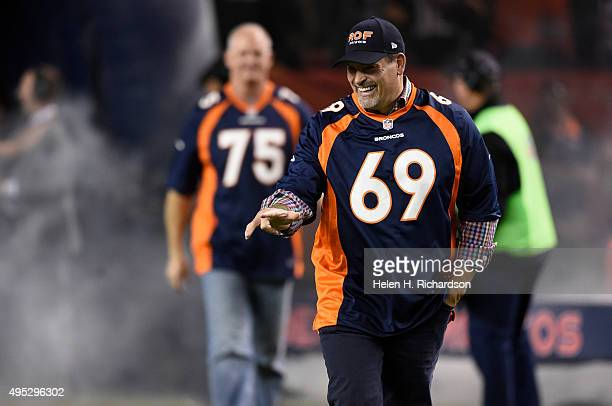 Former Bronco Mark Schlereth is announced as the 1997 Broncos team is honored before the game The Denver Broncos played the Green Bay Packers at...