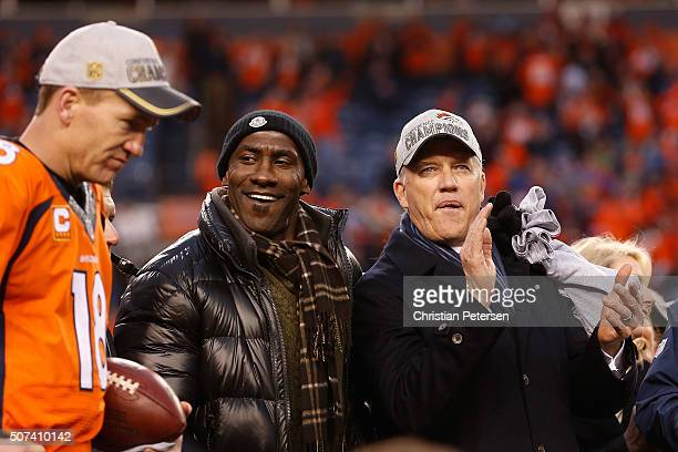 Former Bronco Terrell Davis and General Manager and Executive Vice President of Football Operation for the Denver Broncos John Elway celebrate after...