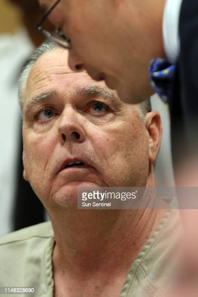 Former Broward Sheriff's Office deputy Scot Peterson meets with defense attorney Joseph DiRuzzo during a hearing at the Broward County Courthouse in...