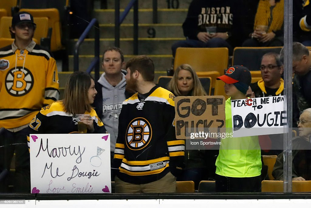Former Bruin Calgary Flames defenseman Dougie Hamilton (27) still has his fans in Boston during a regular season NHL game between the Boston Bruins and the Calgary Flames on November 25, 2016, at TD Garden in Boston, Massachusetts. The Flames defeated the Bruins 2-1.