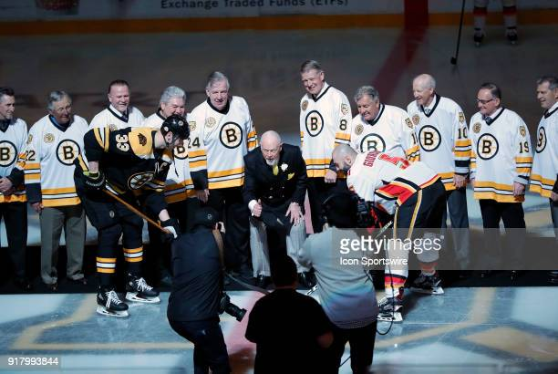 Former Bruins head coach Don Cherry drops the puck with 10 of the 11 Bruins from his 197778 Bruins team who scored 20 goals that season From left to...