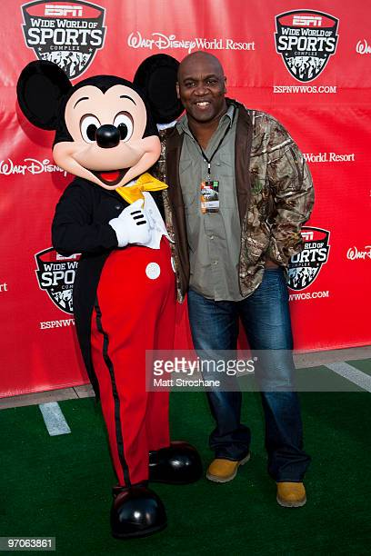 Former Buffalo Bill Thurman Thomas walks the red carpet with Mickey Mouse at the official relaunch of the ESPN Wide World of Sports at Walt Disney...