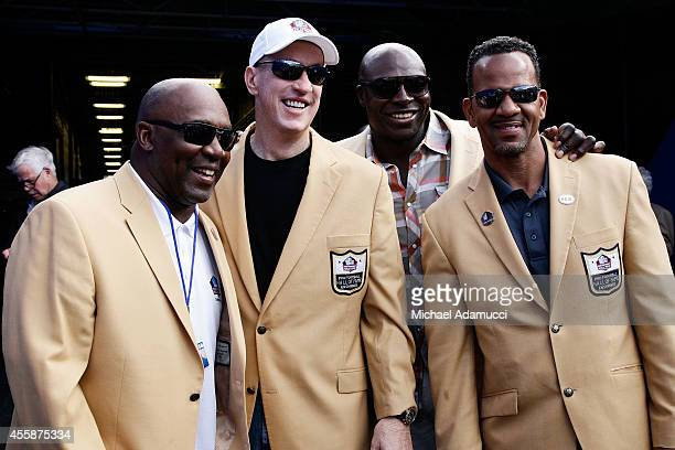 Former Buffalo Bills and NFL Hall of Fame members Thurman Thomas Jim Kelly Bruce Smith and Andre Reed wait to take the field at halftime for a...