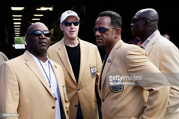 Former Buffalo Bills and NFL Hall of Fame members Thurman Thomas Jim Kelly Andre Reed and Bruce Smith wait to take the field at halftime for a...