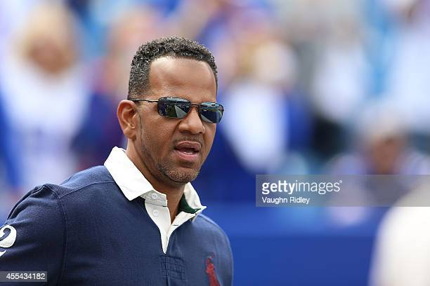 Former Buffalo Bills Andre Reed watches from the sidelines before the game between the Buffalo Bills and the Miami dolphins at Ralph Wilson Stadium...