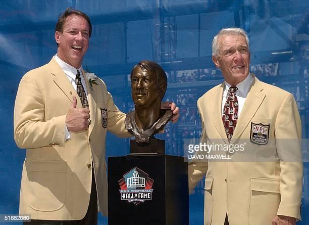 Former Buffalo Bills quarterback and Pro Football Hall of Fame enshrinee Jim Kelly and his presenter former Buffalo Bills head coach and 2001 Hall of...