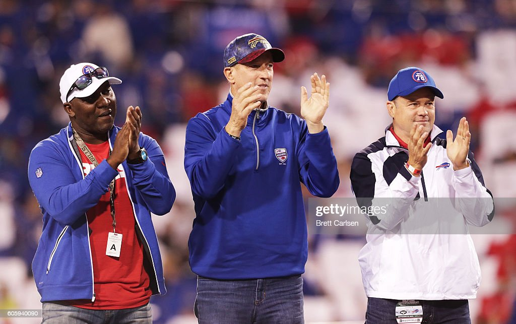 Former Buffalo Bills Thurman Thomas, Jim Kelly and Steve Tasker listen to Hall of Famer Bruce Smith during halftime in a game against the Buffalo Bills and the New York Jets at New Era Field on September 15, 2016 in Orchard Park, New York.