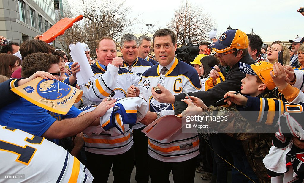 Former Buffalo Sabres players (L-R) Randy Burridge, Wilf Paiement and Pat LaFontaine are greeted by thousands of fans during the team's 40th anniversary alumni weekend before the game between the Sabres and the Philadelphia Flyers at HSBC Arena on March 8, 2011 in Buffalo, New York.