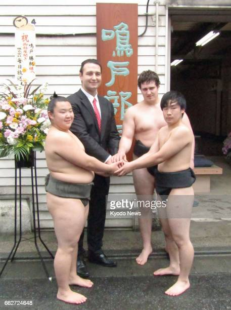 Former Bulgarian ozeki Kotooshu poses for photos with his disciples in Tokyo on April 1 when the now sumo elder Naruto launched his own stable ==Kyodo