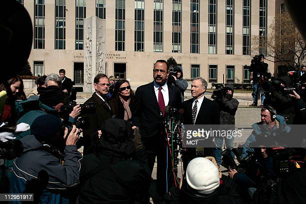 Former Bush White House aide Lewis 'Scooter' Libby listens to his attorney Theodore Wells as they face the media outside the US Federal Courthouse in...