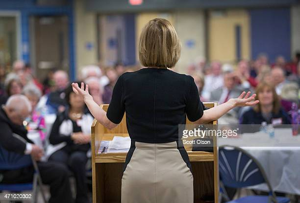 Former business executive Carly Fiorina addresses guests at the Johnson County Republicans Spaghetti Dinner at Clear Creek Amana High School on April...