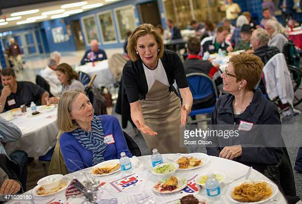 Former business executive Carly Fiorina greets guests at the Johnson County Republicans Spaghetti Dinner at Clear Creek Amana High School on April 24...