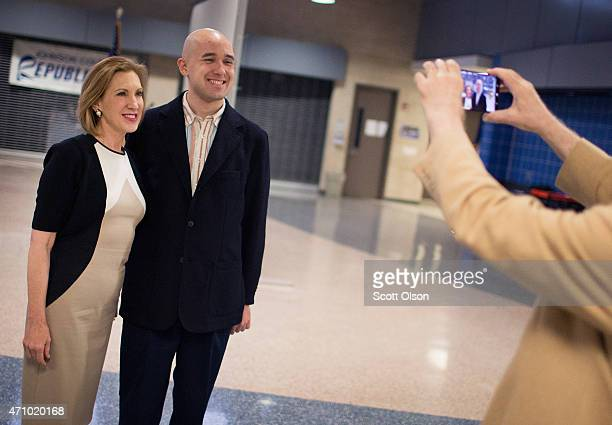 Former business executive Carly Fiorina poses for a picture with a guest at the Johnson County Republicans Spaghetti Dinner at Clear Creek Amana High...