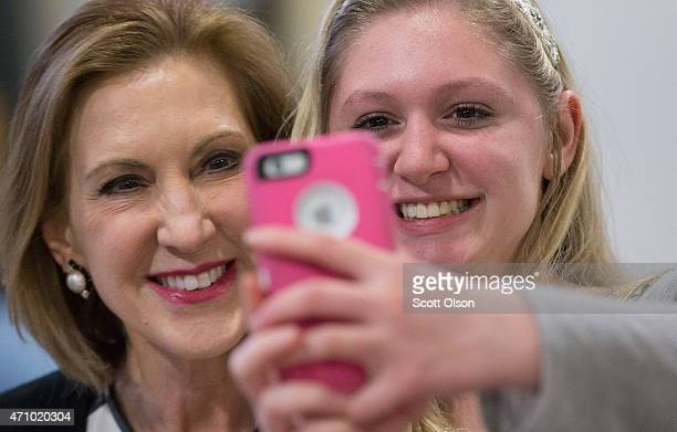 Former business executive Carly Fiorina poses for a selfie with Ashlynn Dale at the Johnson County Republicans Spaghetti Dinner at Clear Creek Amana...