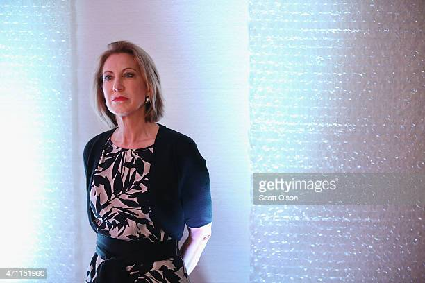 Former business executive Carly Fiorina prepares to speak to guests gathered at the Point of Grace Church for the Iowa Faith and Freedom Coalition...