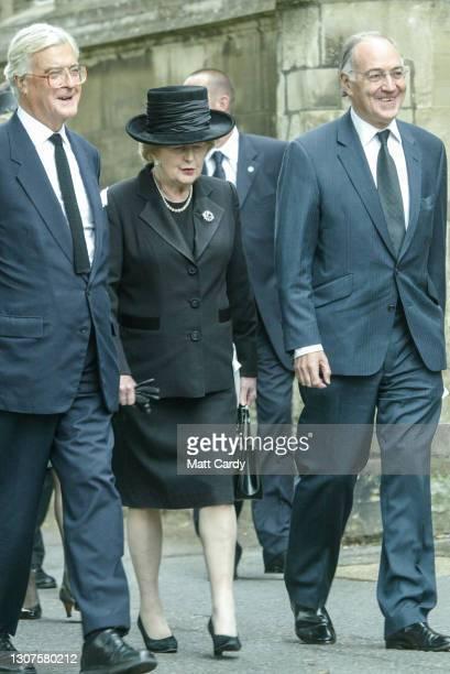 Former cabinet member Kenneth Baker former British Prime Minister Baroness Thatcher and former Conservative Party leader Michael Howard leave after...